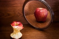 thin apple looking in mirror and seeing fat apple